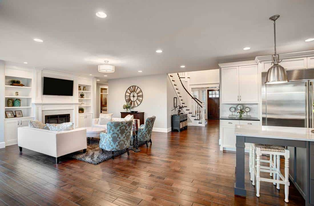 Beautiful new furnished living room in new luxury home with white walls and hardwood floors