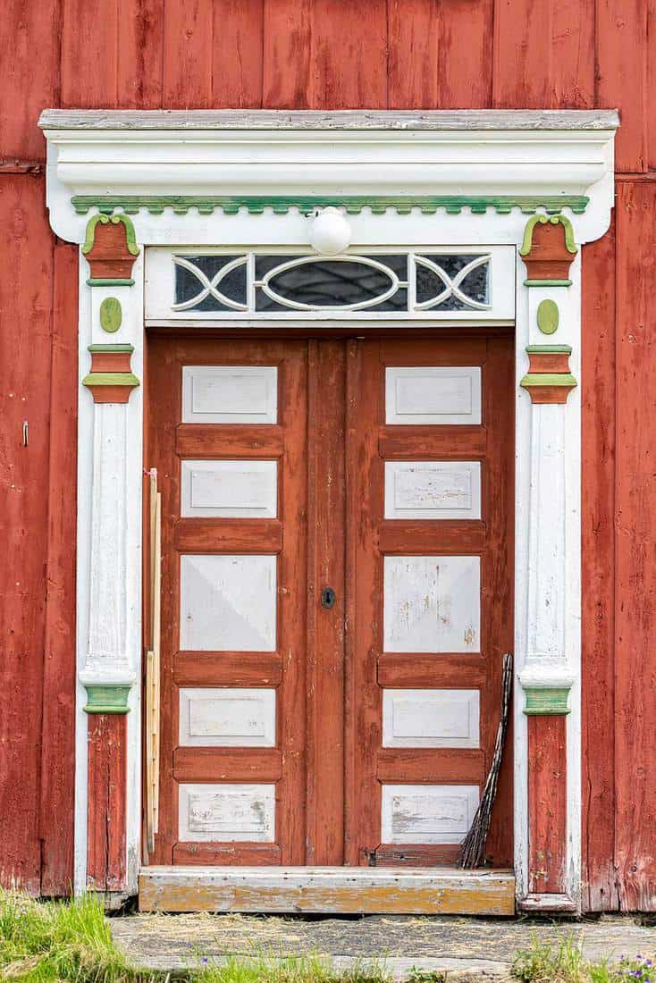 Beautifully crafted and painted old double door with pillars from an old house on the Norwegian countryside