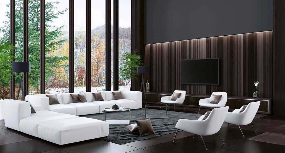 Big luxury villa interior with modern white velvet accent chairs and sofa