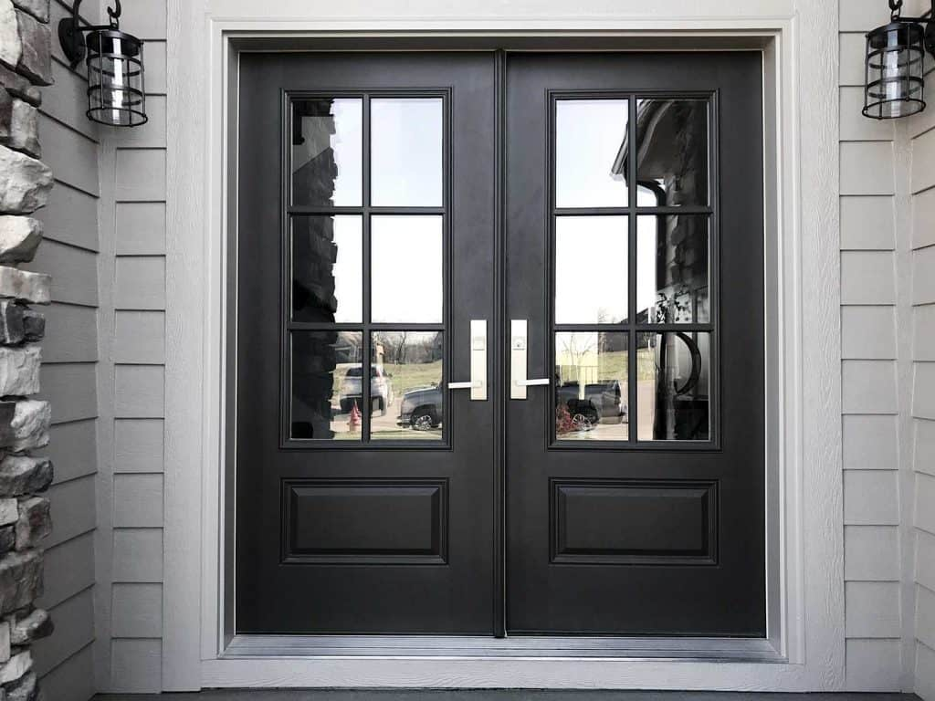 Black double door front entrance of a modern luxury house