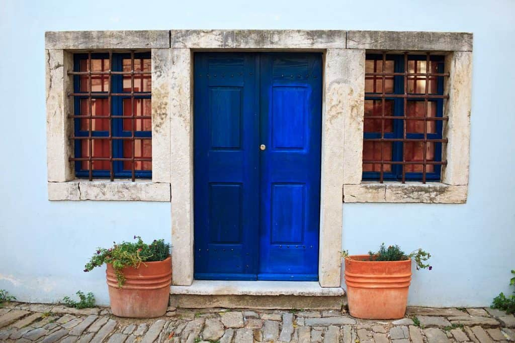 Blue front door and two windows