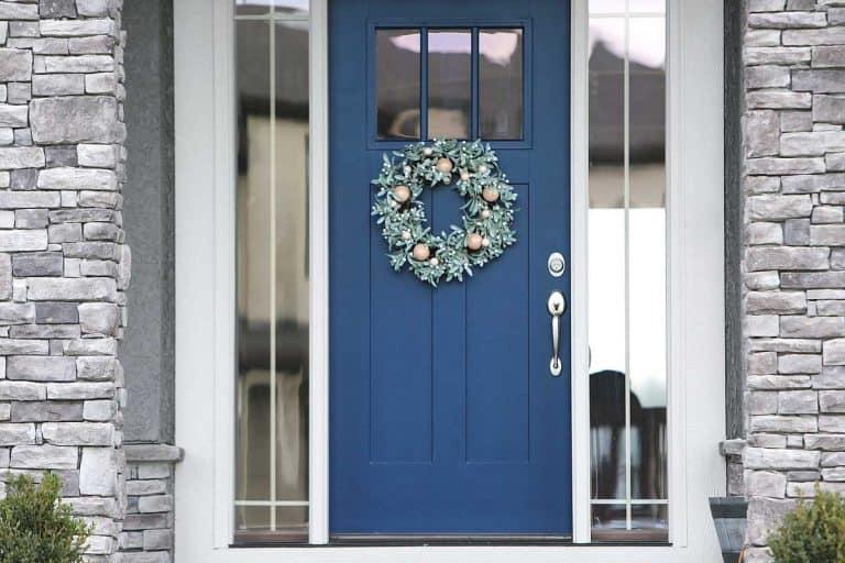 Blue front door of a modern house, 27 Front Door Color Ideas