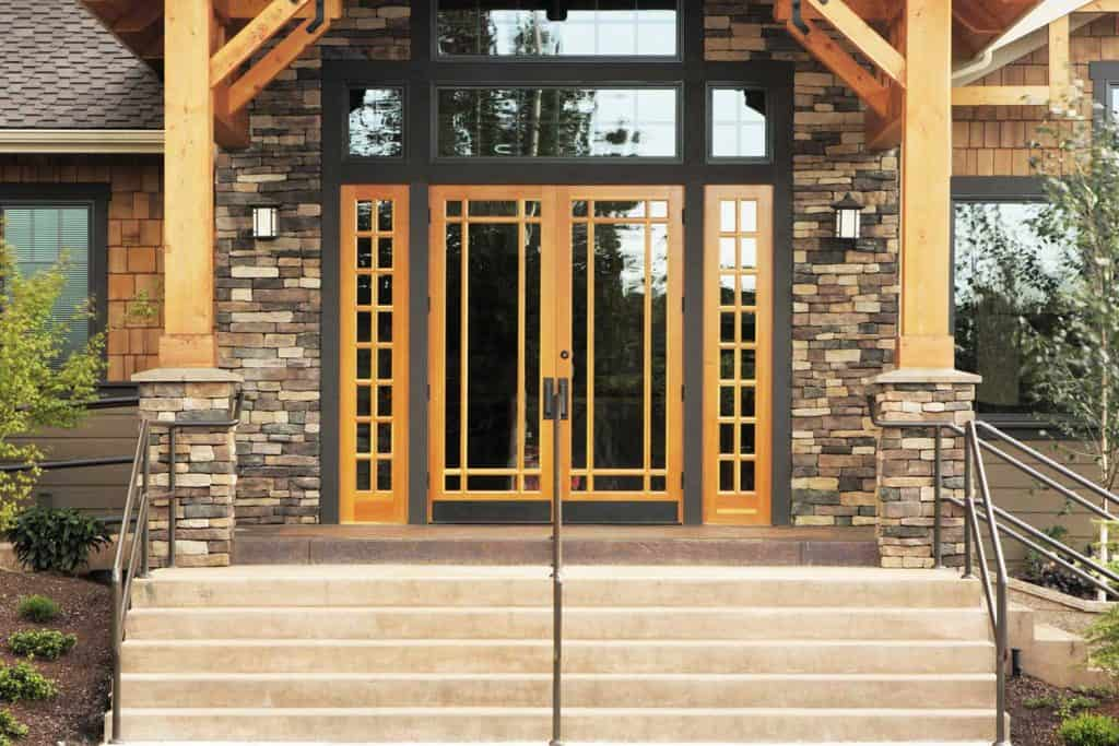 Contemporary stone timber and glass architecture building facade and entrance