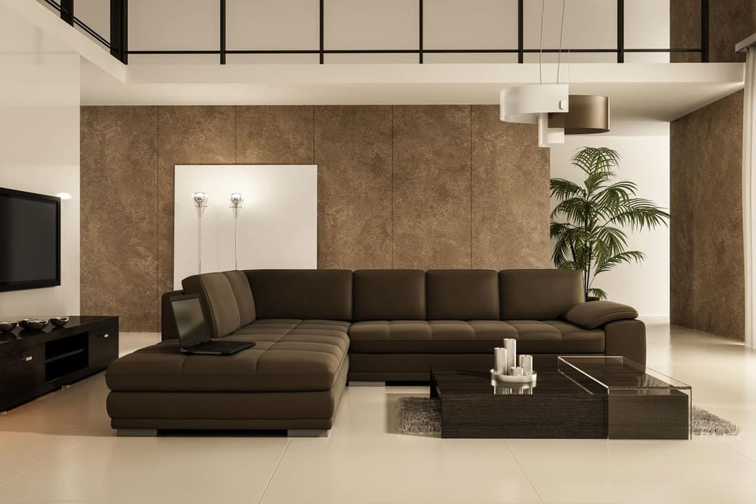 Cream colored living room with dark brown colored sofa