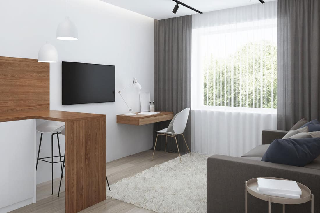 Design a small room with a sofa. 3D rendering.