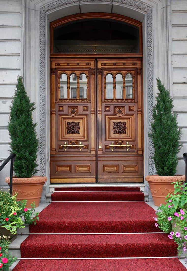 Elegant double wooden door of an upper class apartment building