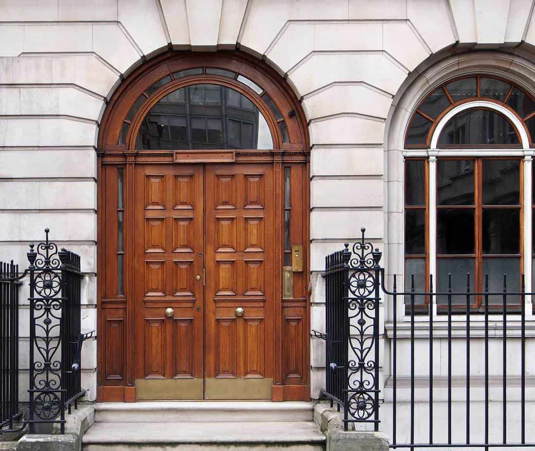 Elegant front door of an expensive townhouse in London
