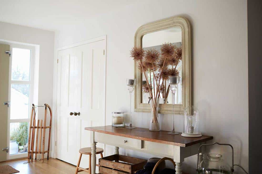 Entrance hall of a contemporary family home with large mirror