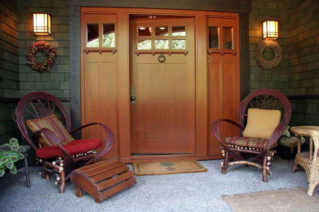 Front porch and entrance of home, rustic front porch with wooden doors, beautiful lighting on front porch