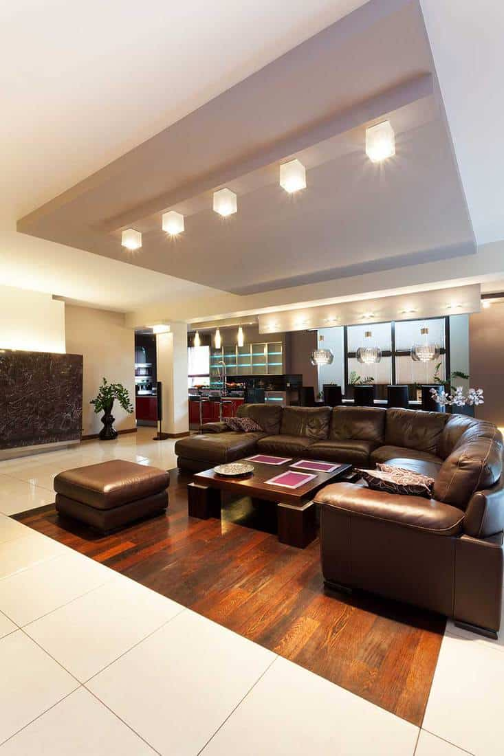 Huge leather sofa and coffee table in a spacious living room