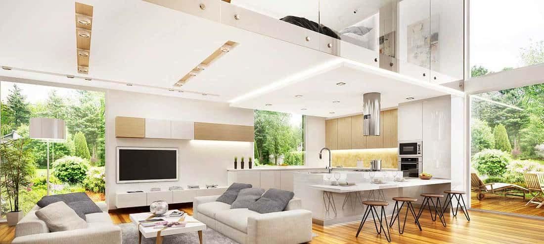 Interior design of a modern open plan kitchen dining living room in a big loft type-house