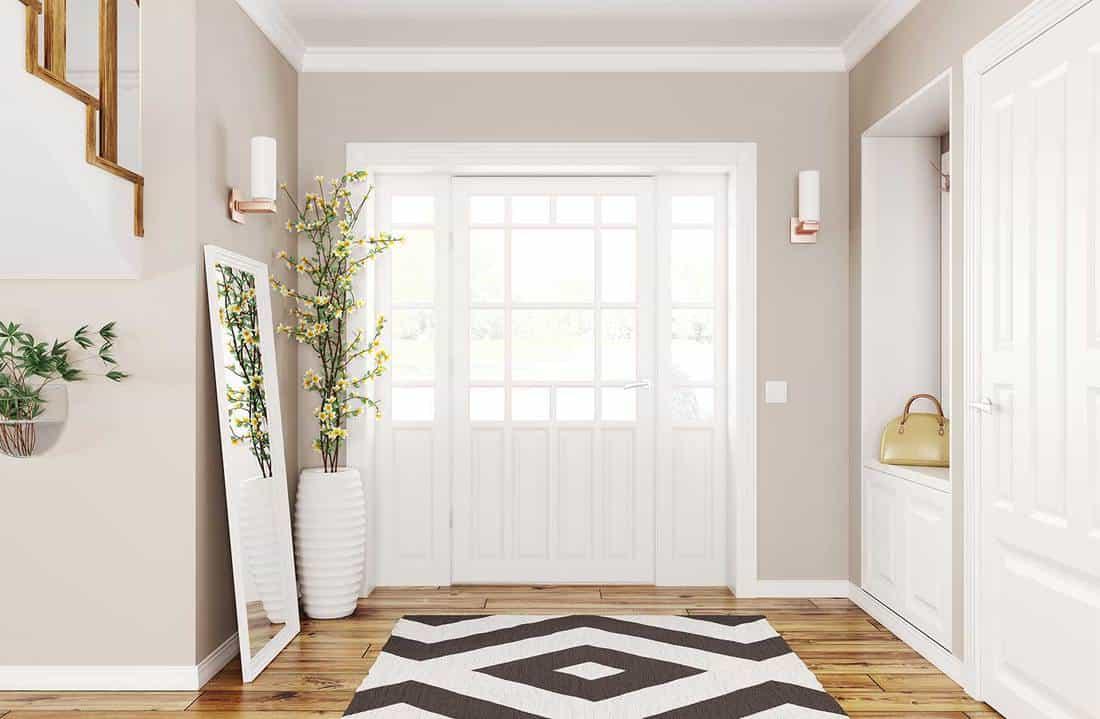 Interior design of modern hallway with white doors, hardwood floor and large mirror