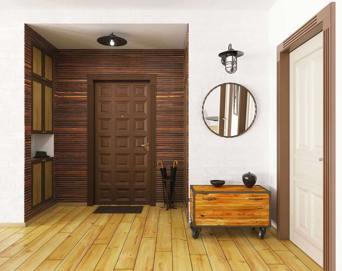 Interior of modern hall with hardwood floor, two doors brown and white