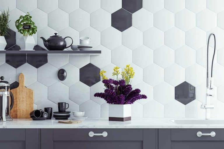Kitchen counter decorated with hexagon shaped tiles with properly placed kitchen utensils, How To Decorate Kitchen Counters [14 Actionable Ideas]
