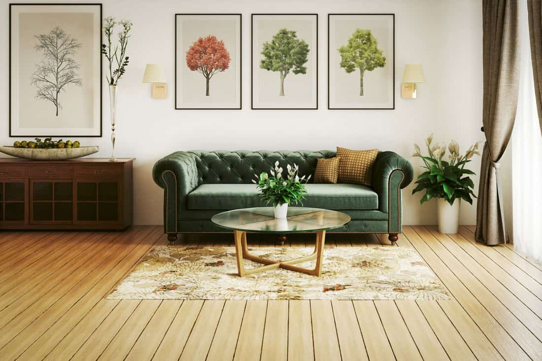 Living room with small tree paintings at wall and wooden flooring