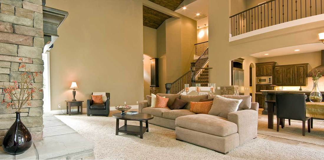 Large living room in luxury home with cozy sofa, armchair and coffee table