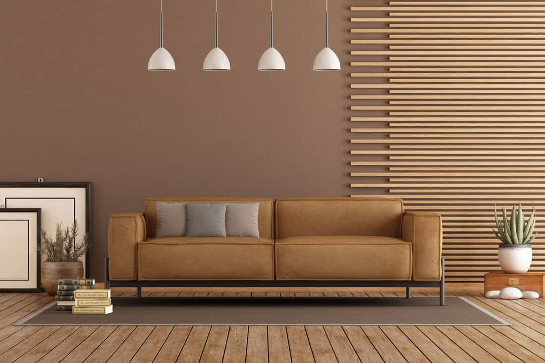 Living room with white hanging lamps and brown couch with matching decorative 1x1 square bars