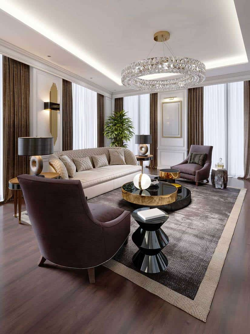 Luxury apartment in modern style with designer furniture and large curtains
