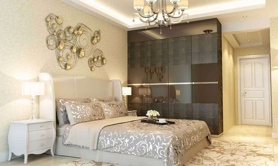 Luxury designed bedroom interior in hotel room with beautiful wall decoration