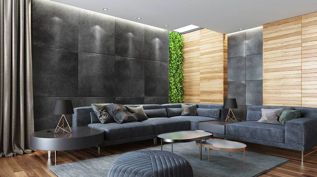 Modern country style luxury house living room with elegant gray velvet sectional sofa, ottoman, thick gray carpet and plant vertical wall
