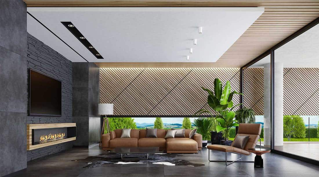 Modern country style villa living room with eco fireplace, big flat TV screen and leather furniture