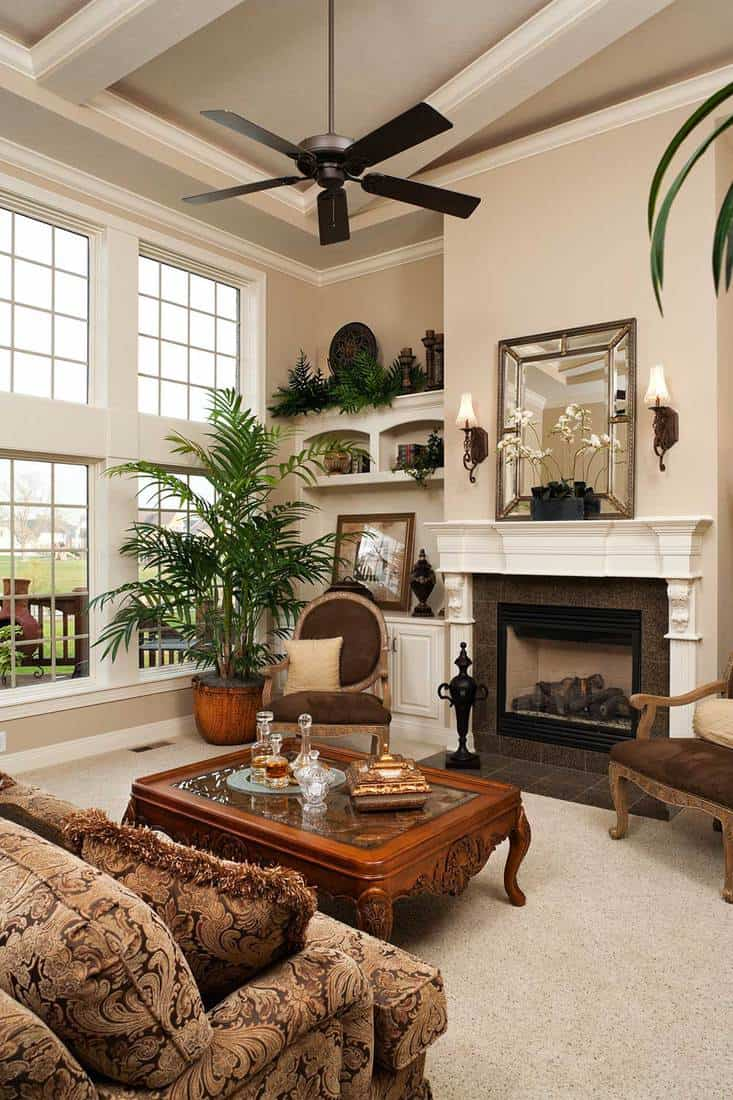 Modern living room with fireplace and light nuetral decor in an upscale custom built residential home