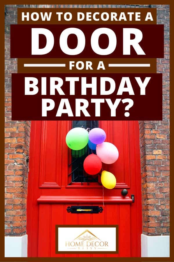 Red entrance door of a brick wall residential house with various colored balloons for a birthday party