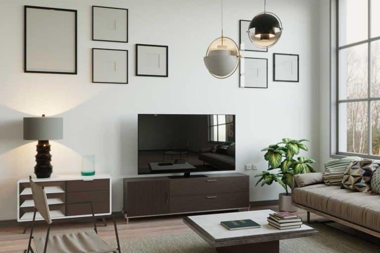 Scandinavian style living room with flat screen tv and framed wall decor, How To Decorate The Wall Around Your TV