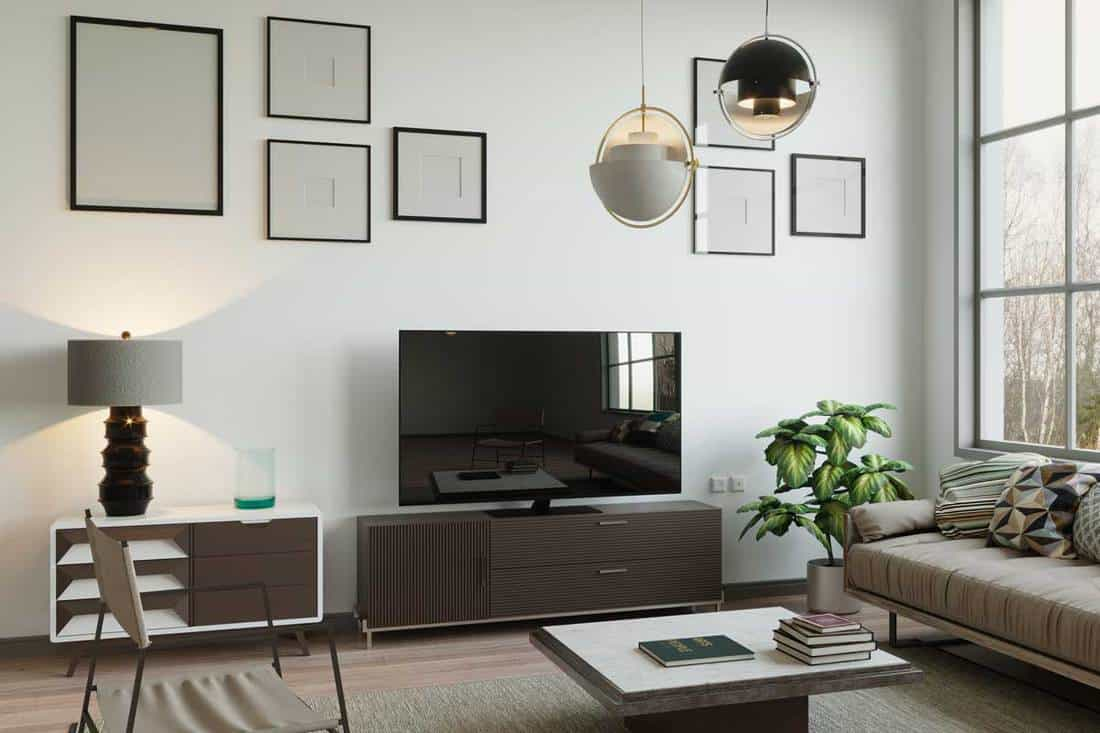 Scandinavian style living room with flat screen tv and framed wall decor