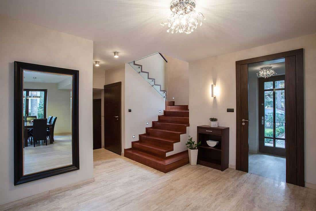 Travertine house interior with hallway, stairs and entrance