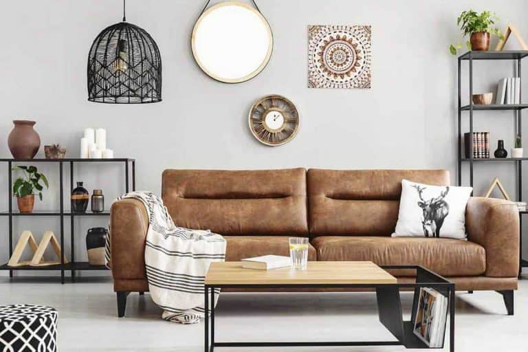Warm ethno living room with big comfortable leather couch and metal furniture, 24 Living Room Mirror Decorating Ideas [With Pictures]
