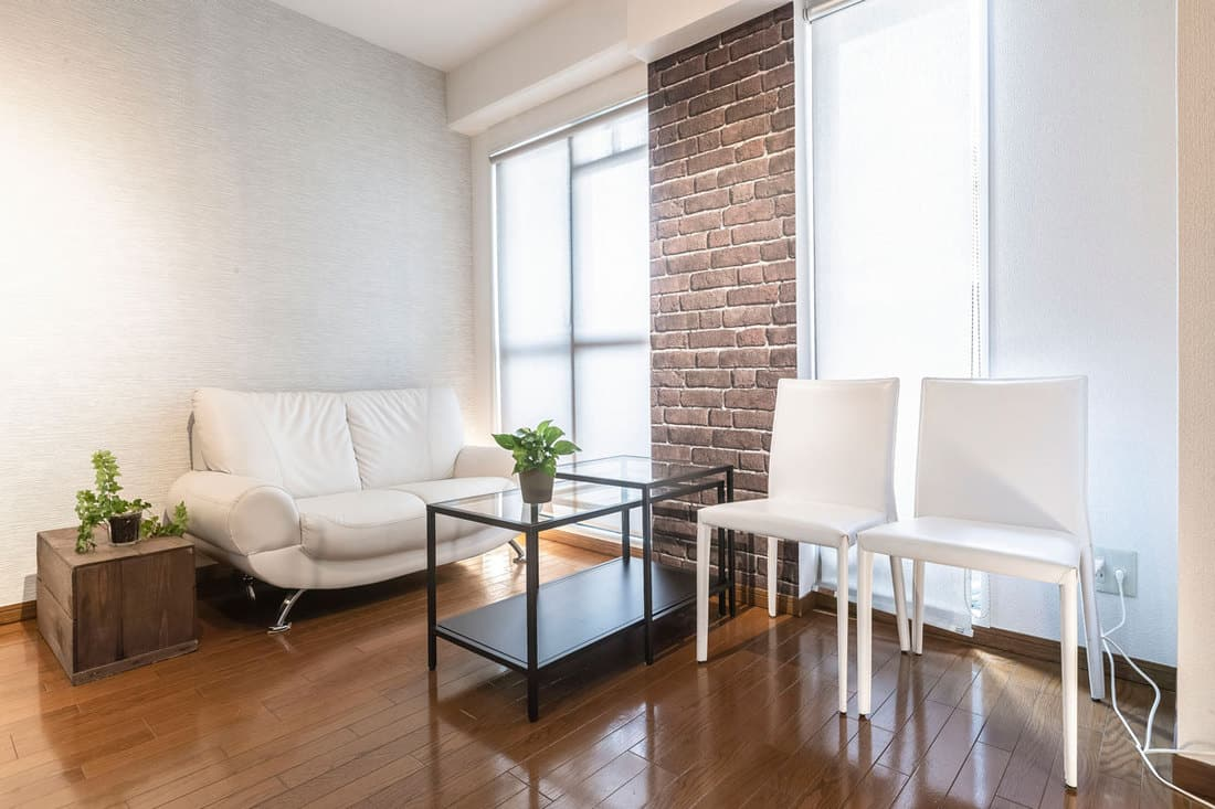 White colored walls and white furnitures with shinny wooden floor deck