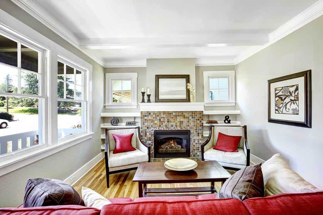 White colored walls and wooden flooring with fireplace at the middle