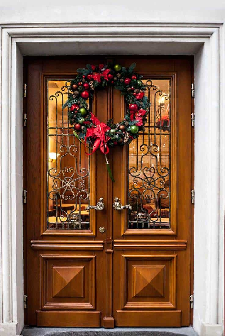 Wooden double door decorated with Christmas wreath