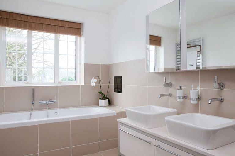 Bathroom with mirror cabinets, white sinks, and brown tiles, 7 Bathroom Tiles Cleaning Hacks