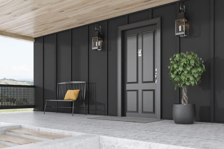 Black themed facade with black industrial lamps and black hardwood door, 35 Black Front Door Ideas [Photo Inspiration]