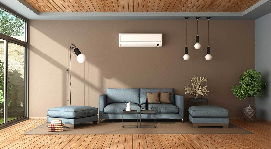 Blue and brown living room with air conditioner, sofa and footstool