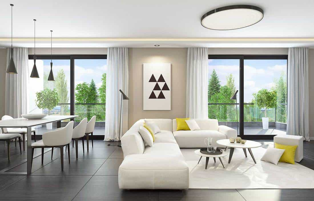 Fresh and modern white style living room interior with dining table