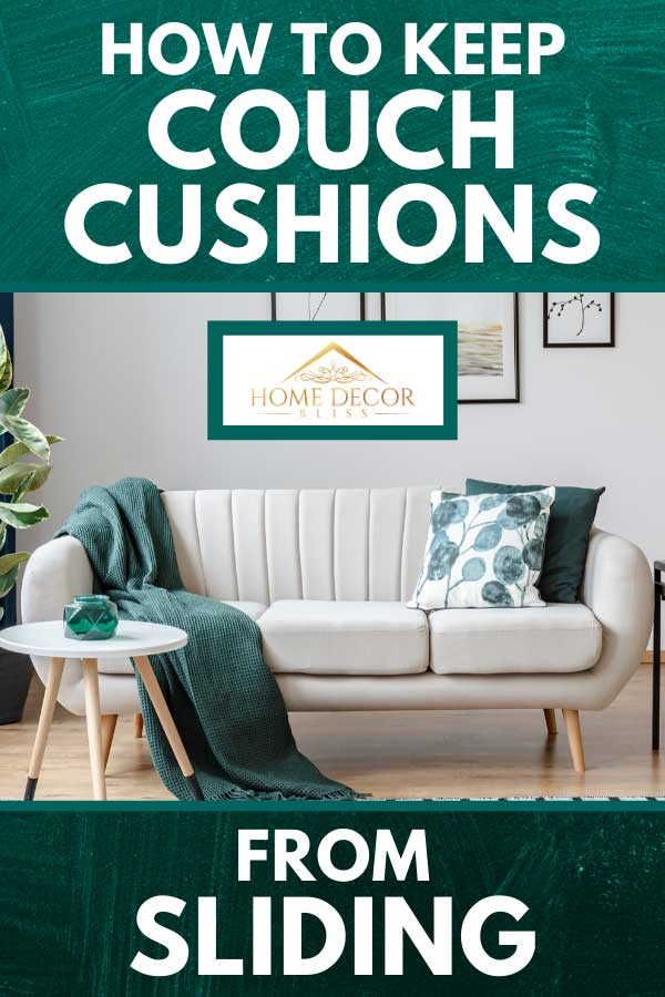 White couch with throw pillows and green blanket in cozy apartment living room, How to Keep Couch Cushions From Sliding