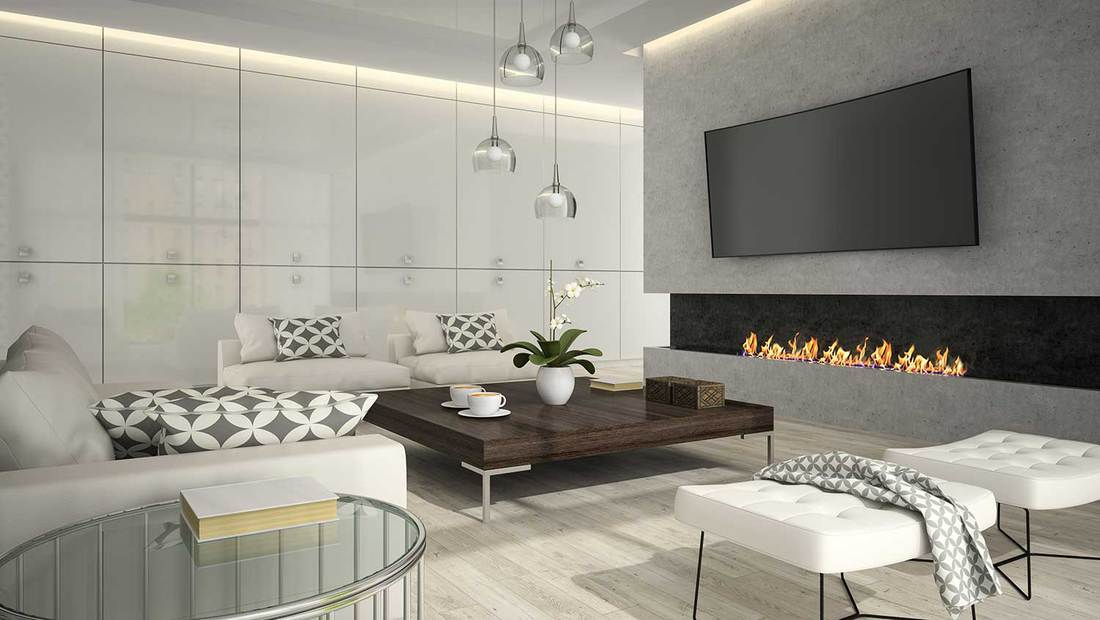 Interior of a luxury white living room with stylish fireplace, TV and cozy sofa