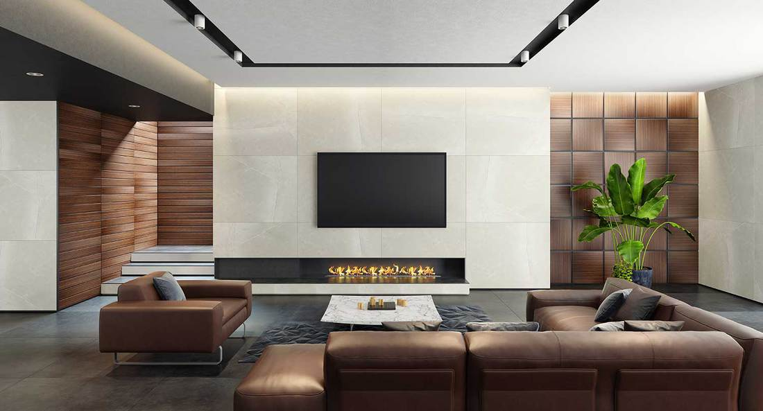 Luxurious big living room with walls covered with natural stone and wood wall coverings, leather sofa and eco fireplace