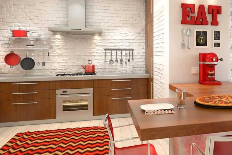 Luxury modern loft apartment kitchen with brick walls and red decors, 15 Awesome Red Kitchen Wall Decor Ideas