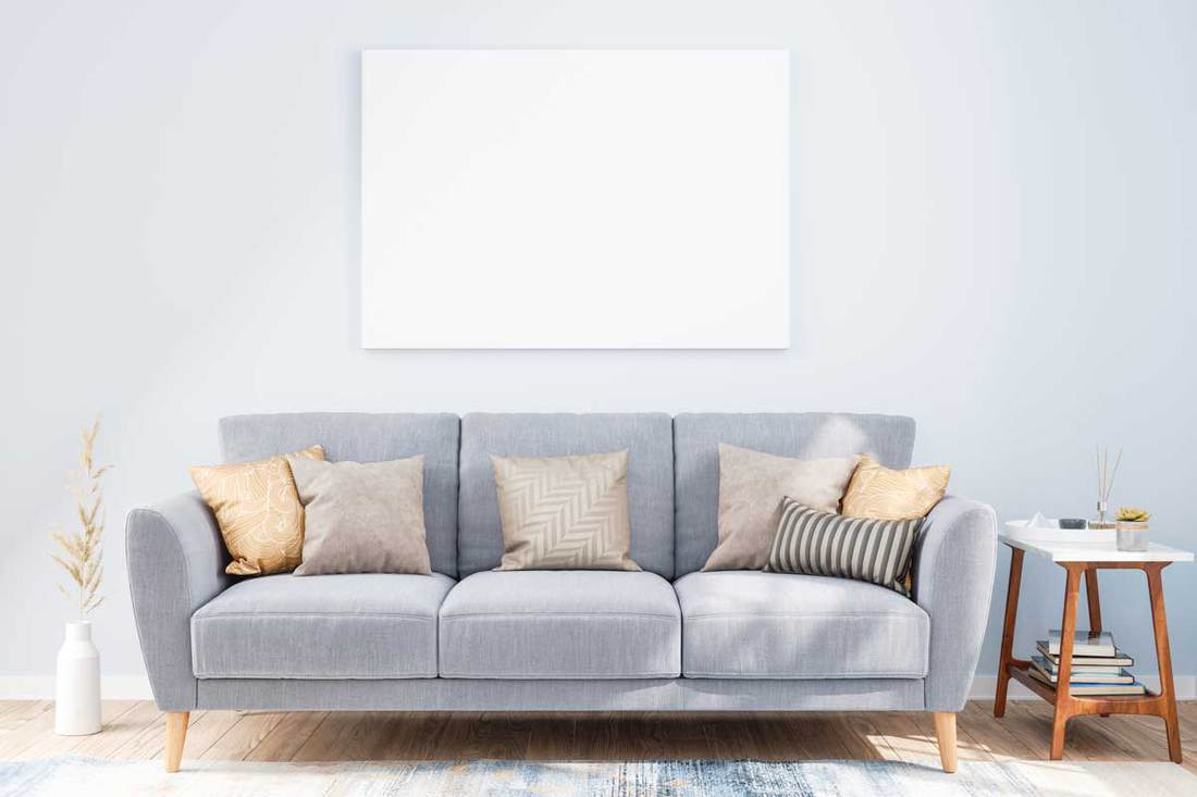 Mockup Frame on Living Rooms Wall with Sofa
