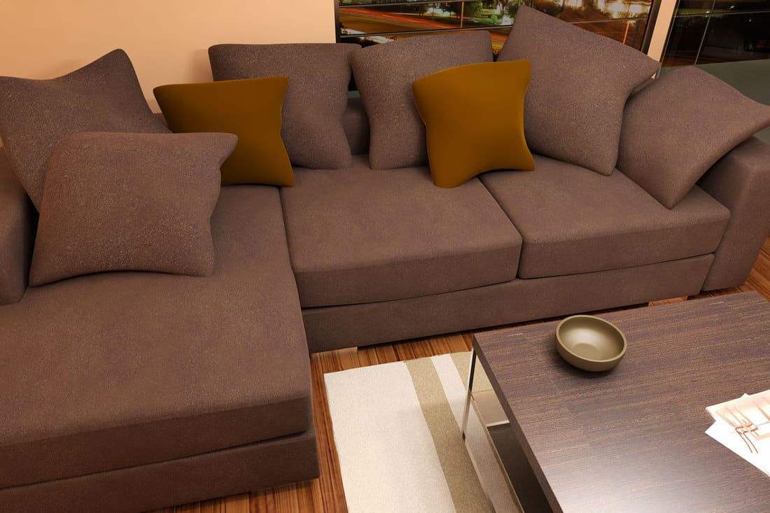 Modern bright living room with brown sofa, throw pillows, and brown furniture