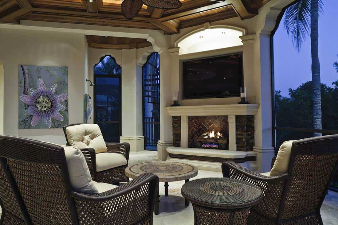 Outdoor sitting area with fireplace in a tropical setting at an estate home