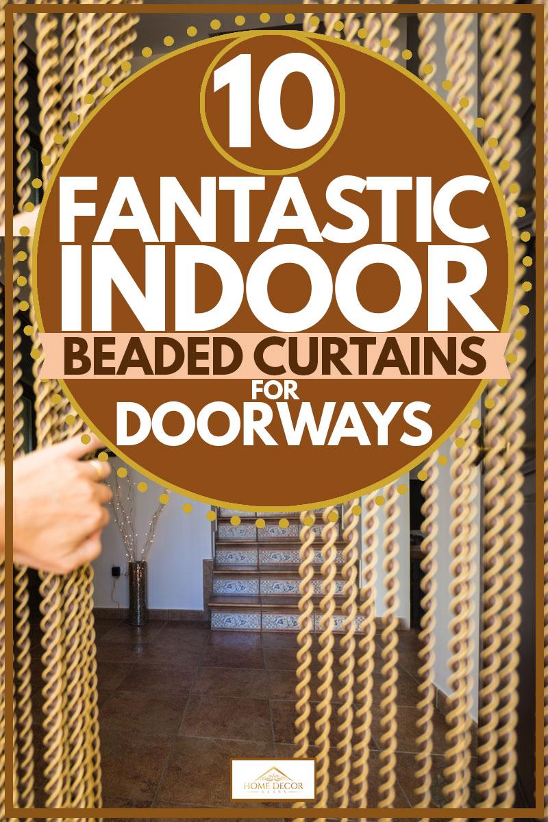 Woman shoving gold beaded curtain at doorway, 10 Fantastic Indoor Beaded Curtains For Doorways