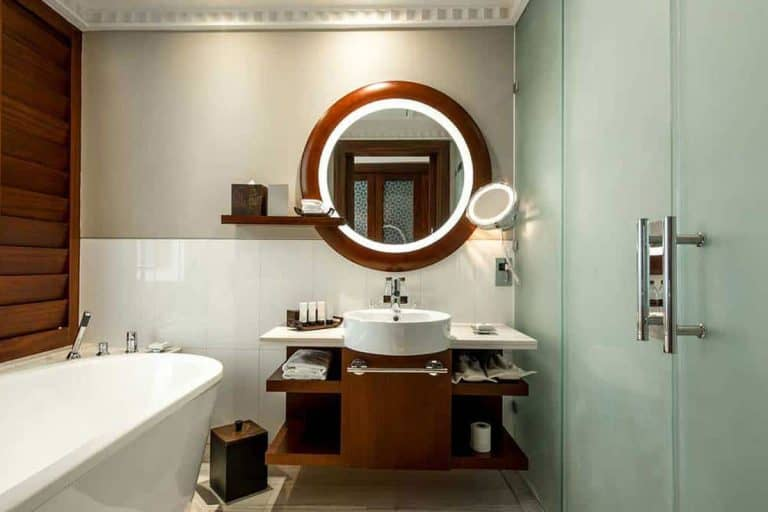 A modern bathroom suite with a nice large round mirror, 43 Bathroom Mirror Decorating Ideas