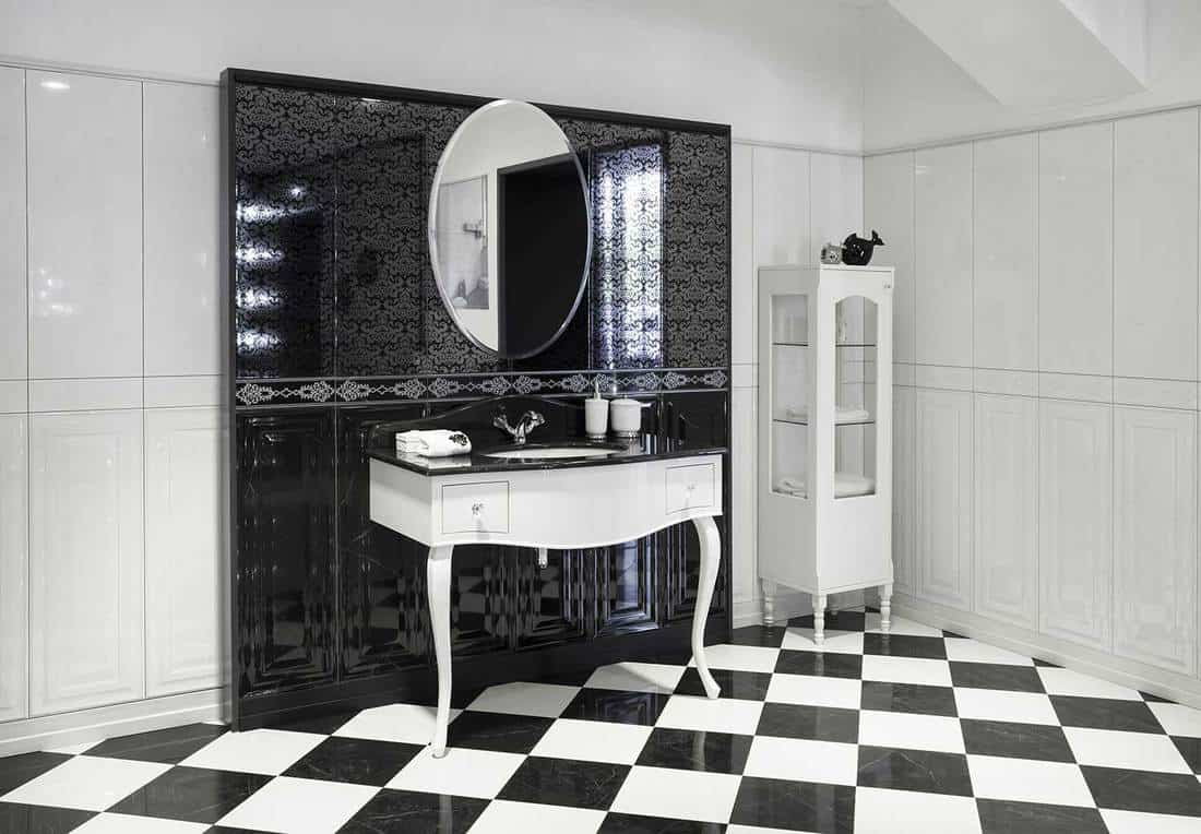 Black and white luxury bathroom interior with mirror and sink