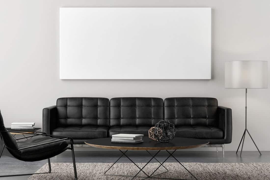 Black couch with tinted glass table at front