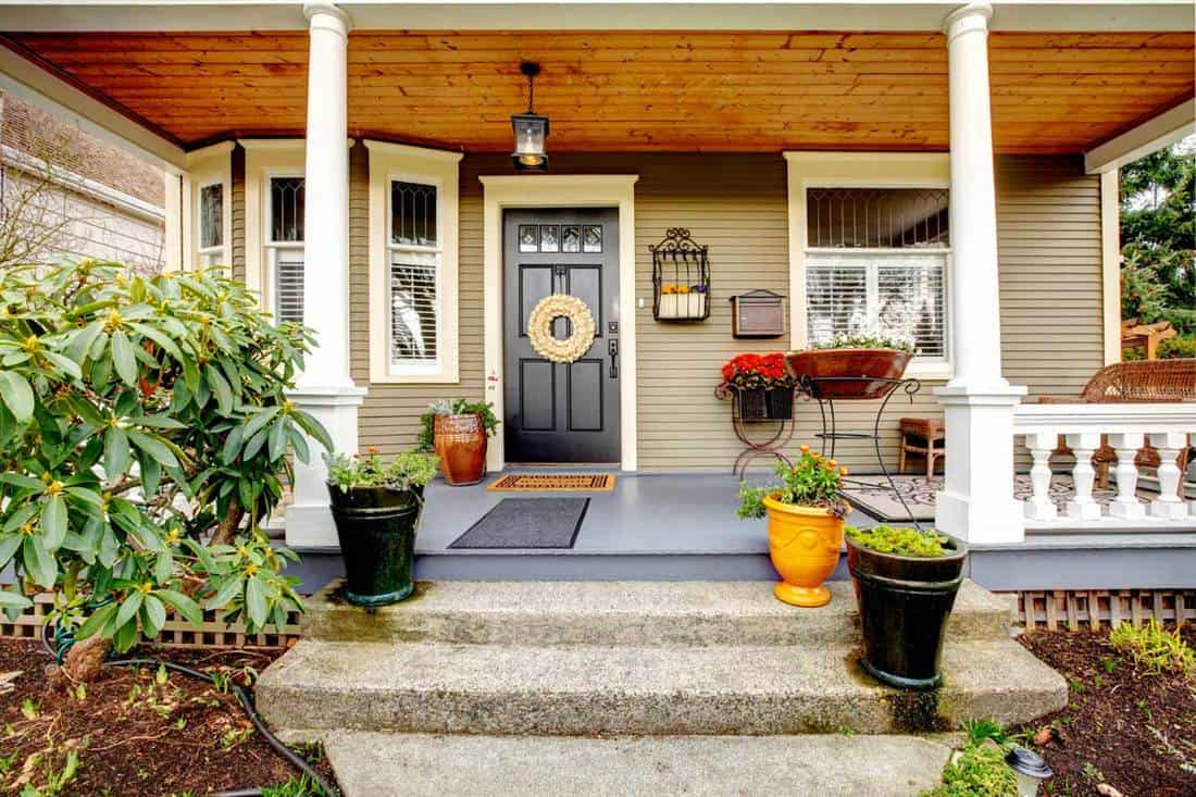 Gorgeous front porch with black door